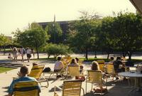 People resting outside next to Centennial Student Union in Mankato State University. 05-16-1989.
