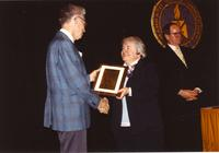 Roy Weier receiving a plaque at the Retirement Banquet at Mankato State University, 1990-05-31.