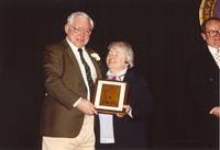 John DiMeglie receiving a plaque at the Retirement Banquet at Mankato State University, 1990-05-31.