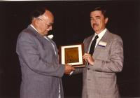 Gerald Stiles (right) receiving a plaque at Mankato State University, 1990-05-31.