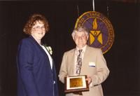 Duane Orr presenting a plaque at the retirement banquet at Mankato State University, 1990-05-31.