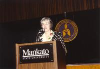 Sherily giving a speech at Mankato State University, 1990-05-31.