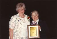 Dr. Aileen Eich (Left) receiving a plaque at Mankato State University, 1990-05-31.