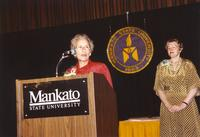 Vy Kalbroach (speaking) and former Mankato State University president Margaret R. Preska (R) 1990-05-31.