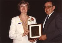 Mary Dooley receiving a plaque at Mankato State University, 1990-05-31.