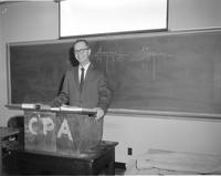Mankato State College, William Montag  -Instructor in Business receives certificate on passing CPA exam, February 18, 1958
