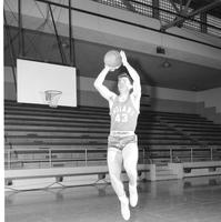 Basketball player number 43 on the Indians shooting a basketball, Mankato State College, March 11, 1958.