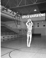 Basketball player number 23 on the Indians, Mankato State College, March 11,1958.