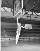 Basketball player number 35 on the Indians going up for a layup, Mankato State College, March 11, 1958.